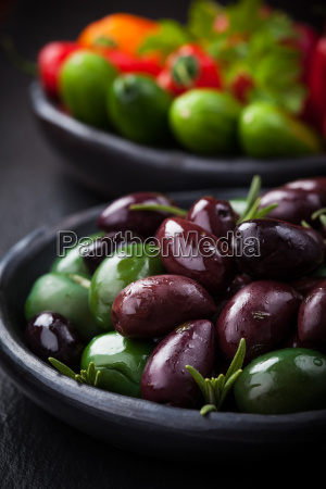 mixed olives with raw snack vegetable