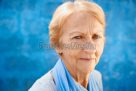 happy old blond woman smiling and