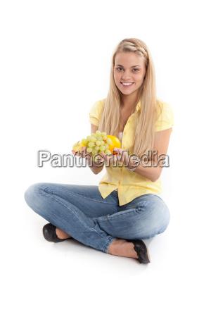 woman presents sitting fruit