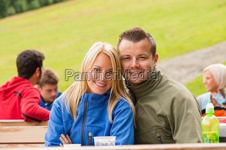 smiling young couple outdoors resting weekend