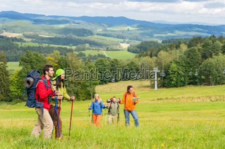 young trekking people enjoying scenic landscape