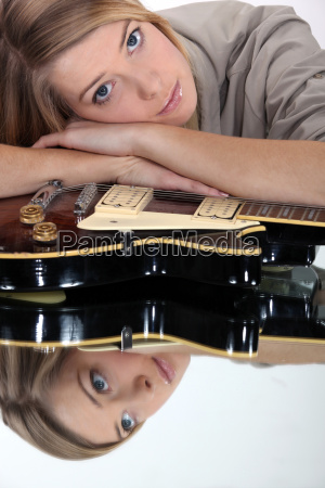 woman with head on her guitar
