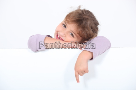 little girl with blank poster