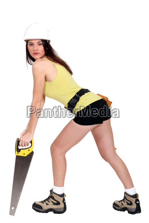 sexy woman with an handsaw