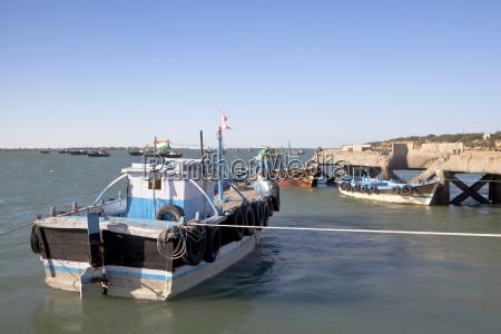 boats moored in dwarka harbor