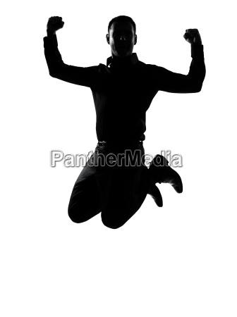 ein geschaeftsmann kraftvolle silhouette springen