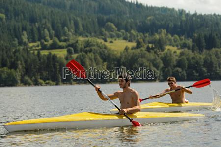 kayaking sporty men on river sunshine