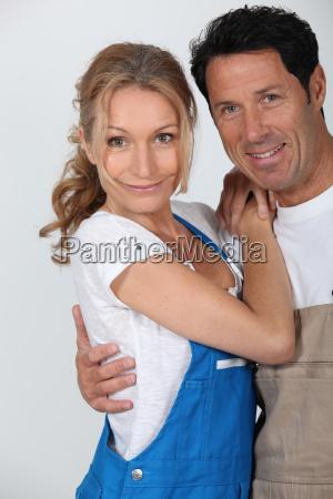 couple wearing work overalls