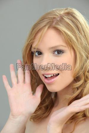 portrait of cute blonde against studio