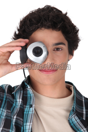 young man hiding his eye with
