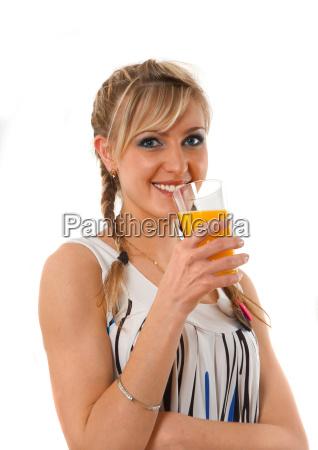 young lady drinking orange juice