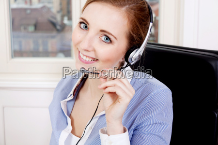young blond woman working in a