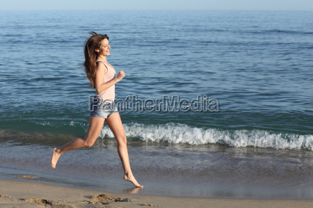 beautiful casual woman running on the