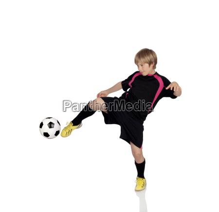 preteen que joga o futebol