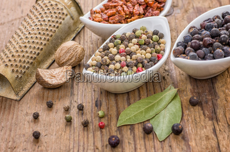 various spices on a wood background