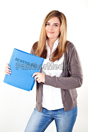 smiling female applicant holding application folder