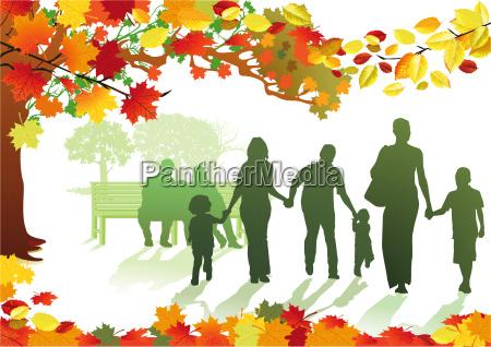 herbstlicher park mit familien