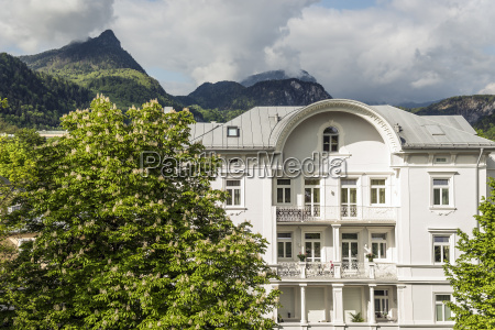 mansion and alps in sun