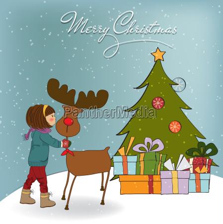 weihnachtskarte mit niedlichen kleinen maedchen streicheln