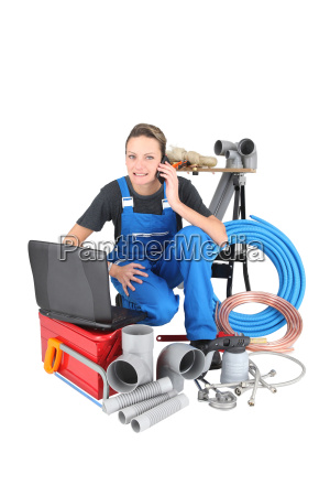 tradeswoman surrounded by building materials and