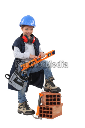 small girl pretending to be construction