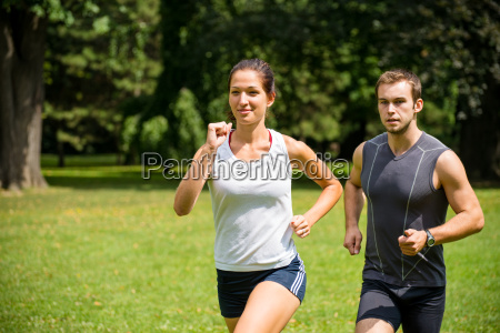 jogging together young couple competing