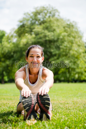 stretching exercise sport woman outdoor