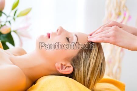 wellness woman receives head massage