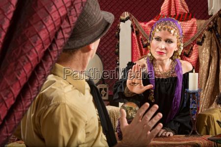 gypsy holding the evil eye