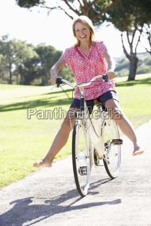 senior woman enjoying cycle ride