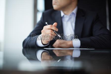 pen in hands