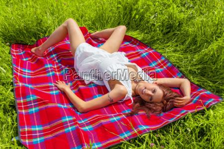 woman is lying in the sun