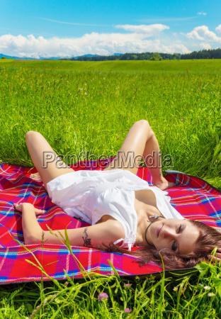 woman lies in the sun