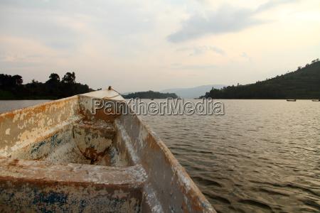 peeling boat reaches into a lake