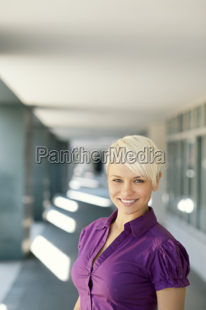 happy businesswoman looking and smiling at