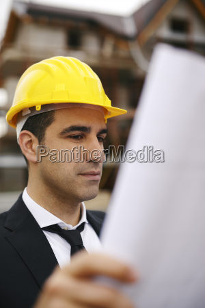 architect in construction site looking at