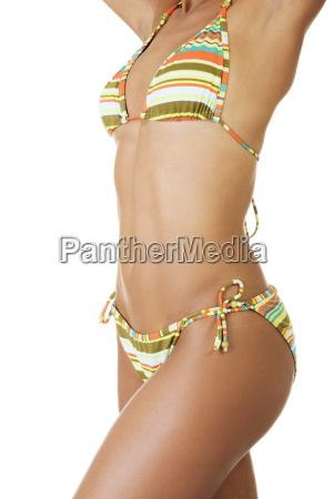 tanned woman body in bikini