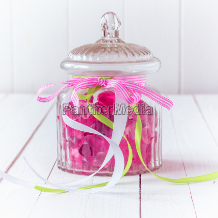 glass candy jar filled with pink