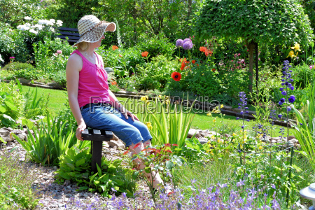 woman is sitting in the summer