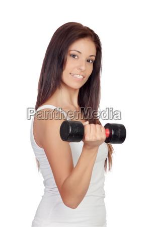 attraktive bruenette maedchen anziehen ihre muskeln