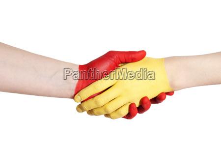 gelb roter handschlag