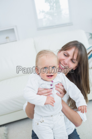 mother sitting on a sofa playing