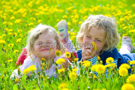 two girls in a spring field