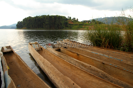 dugout canoes on a lake