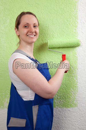 young woman stroking a wall