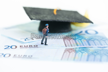 miniature student standing on top of