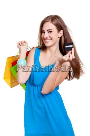 junge glueckliche frau mit bunten einkaufstaschen