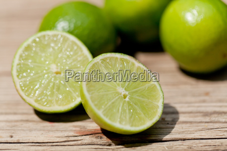 fresh green limes macro closeup in