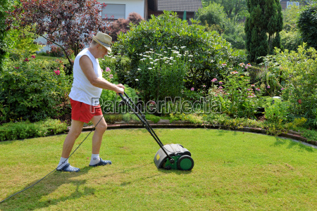 man with lawn fan