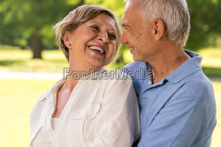 happy retirement senior couple laughing together